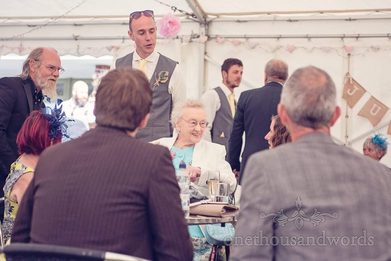 Elderly wedding guest enjoying a Harmans Cross Village Hall Wedding