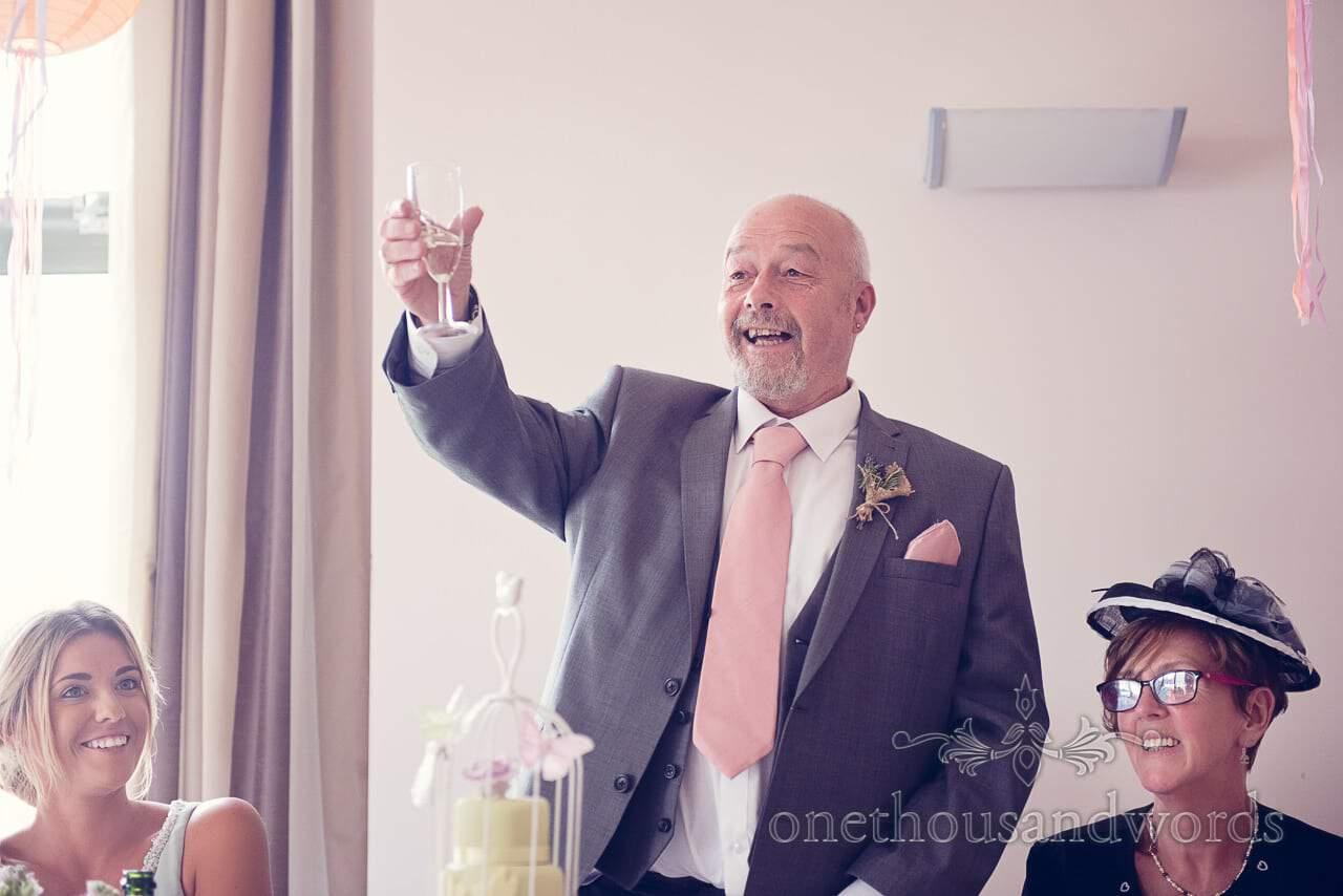 Father of bride raises a toast during wedding speech at Harmans Cross Wedding