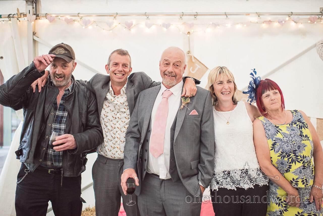 Father of the bride's family photograph at Harman Cross Village Hall Wedding