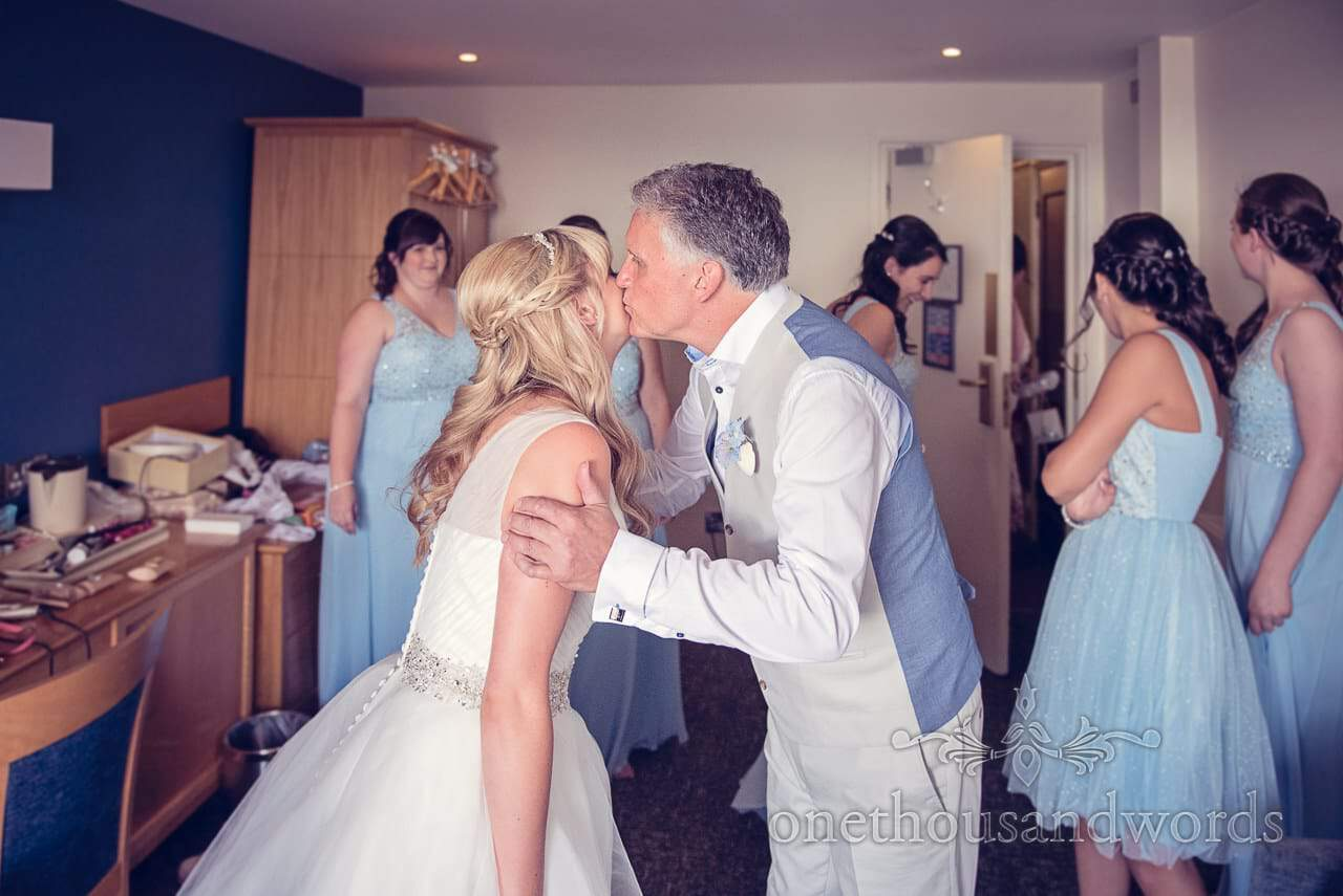 Father of the bride kisses bride on wedding morning at Sandbanks Hotel