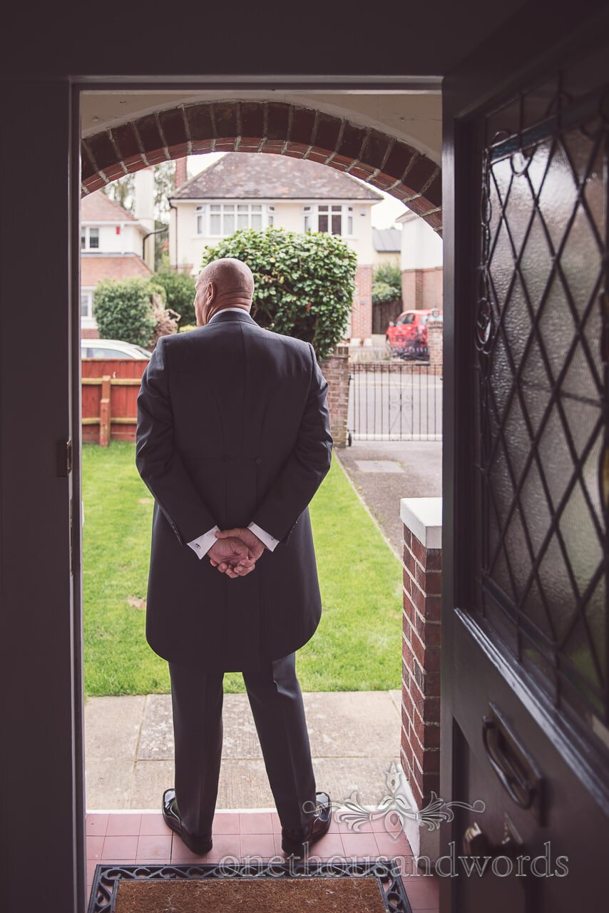 Father of the bride waits in doorway before Harbour Heights wedding