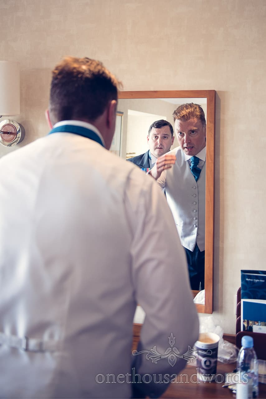 Groom and best man in mirror on morning of Harbour Heights wedding photographs