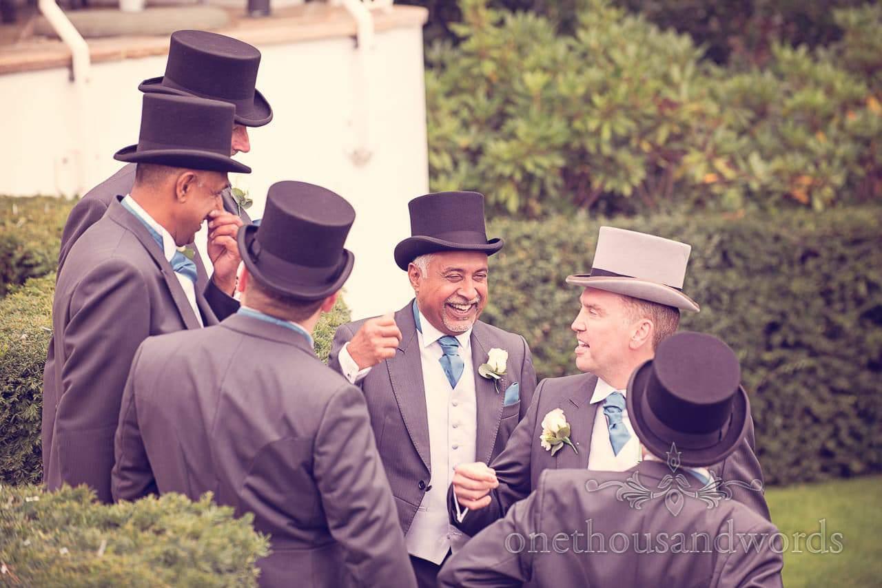 Groom and groomsmen in top hats at Harbour Heights wedding