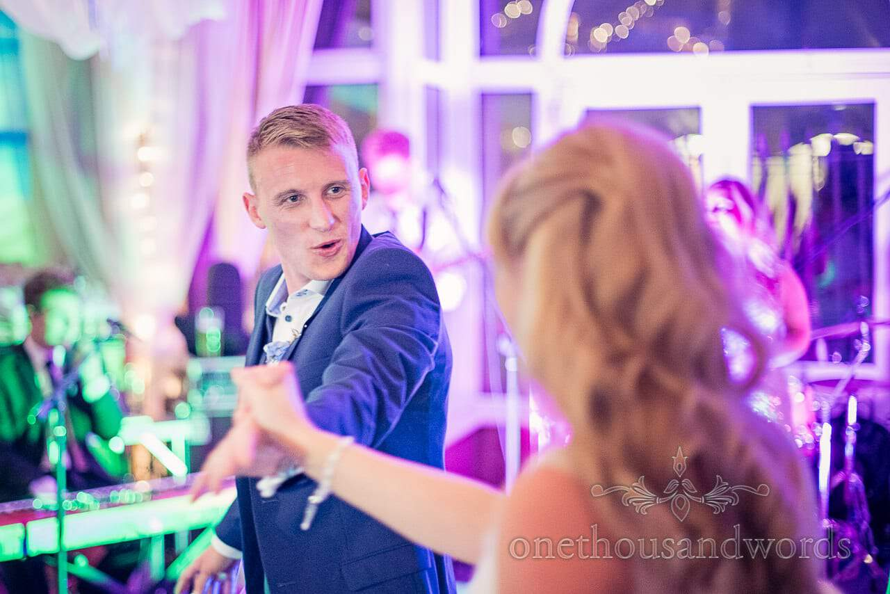 Groom dancing during the first dance at Sandbanks Hotel wedding