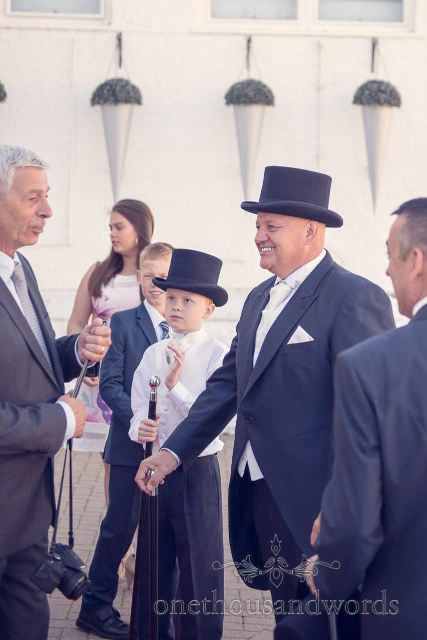 Groom greets guests at Sandbanks Hotel Wedding