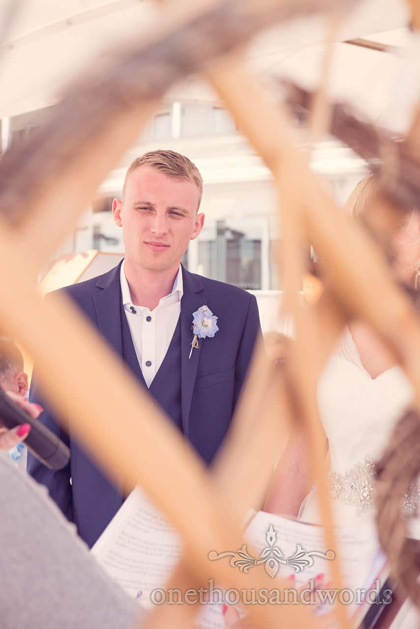 Groom in blue wedding suit at Sandbanks Hotel wedding ceremony