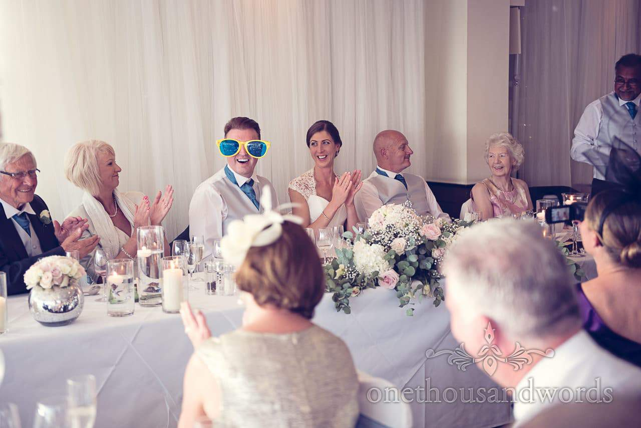 Groom in comedy glasses during best mans speech at harbour heights wedding