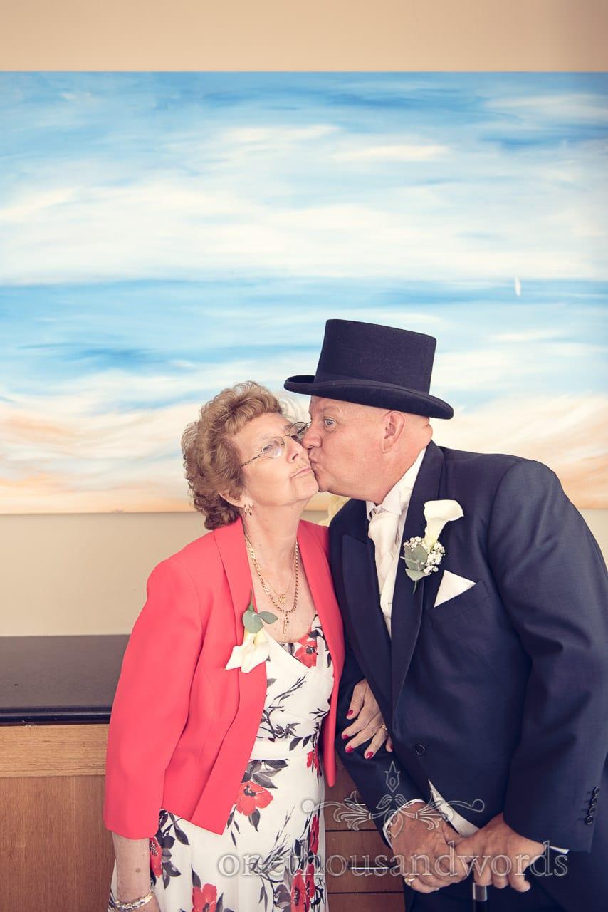 Groom kisses his mum at Sandbanks Hotel Wedding