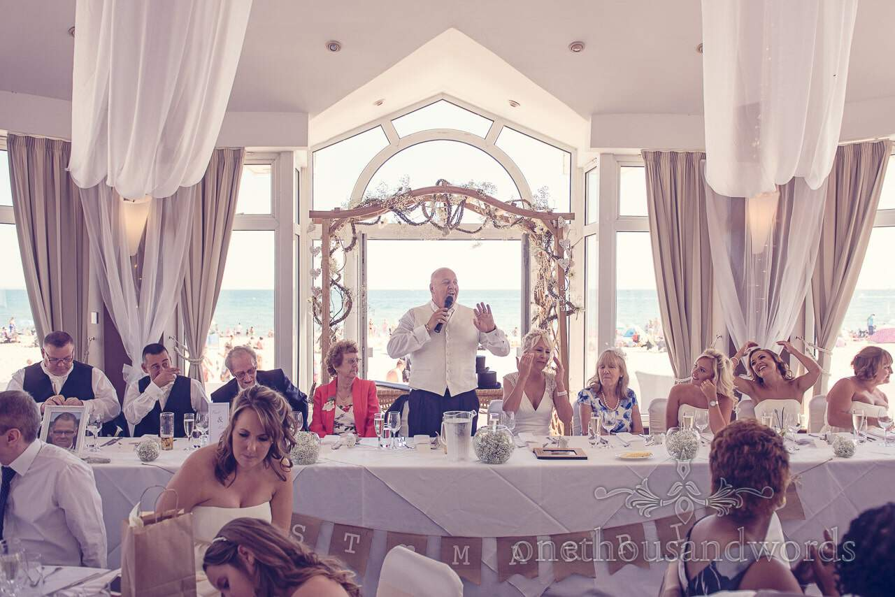 Groom's speech with beach and sea in background at Sandbanks Hotel Wedding
