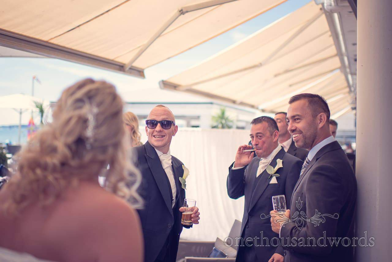 Groomsmen enjoy a drinks reception at Sandbanks Hotel Wedding