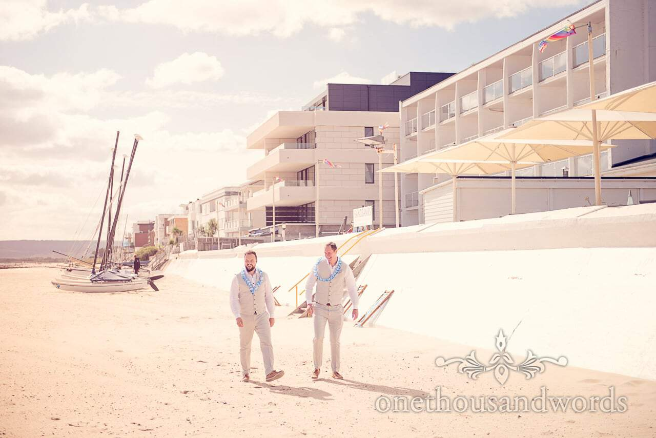 groomsmen in hawaiian leis on Sandbanks Beach at seaside theme wedding photographs