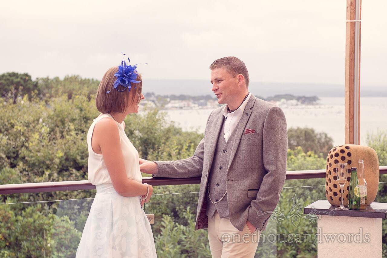 Guests chat on sun terrace at Harbour Heights wedding