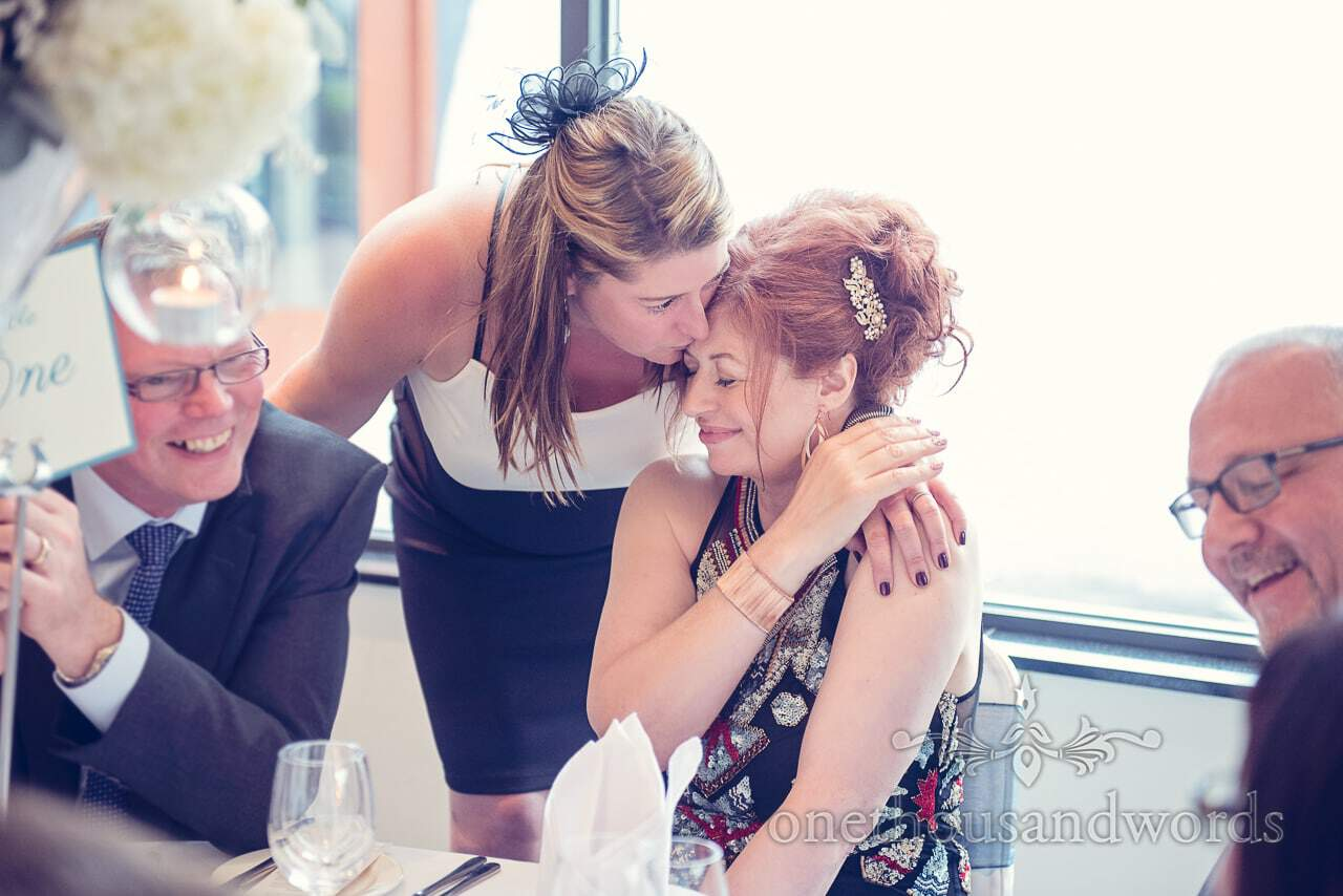 Guests embrace at Harbour Heights wedding