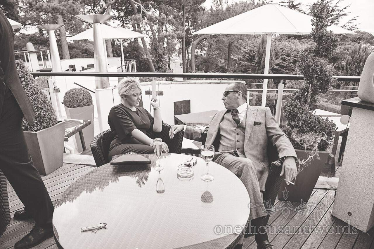 Guests enjoy drink on sun terrace at Harbour Heights wedding