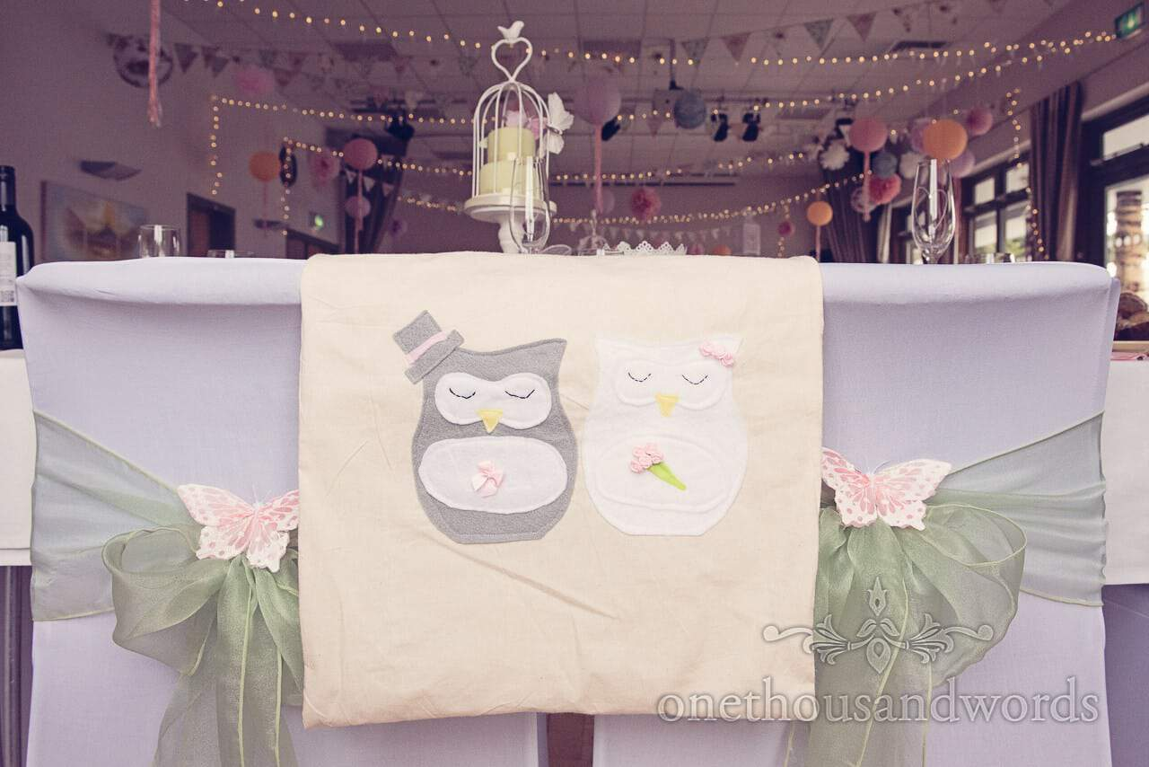 Handmade weding gift bags with bridcage wedding cake, green chair sashes and butterflies