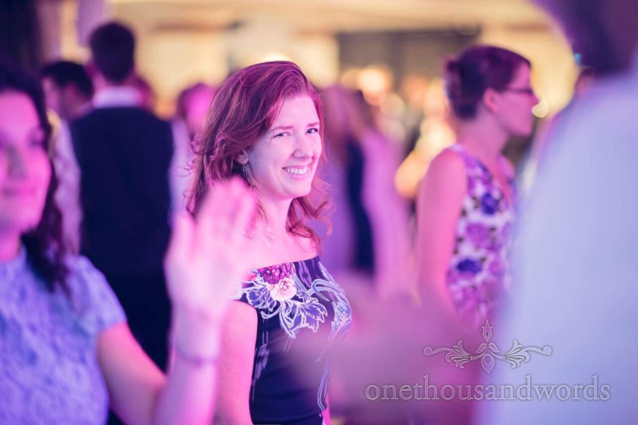 Happy wedding guest dancing at italian villa wedding photographs