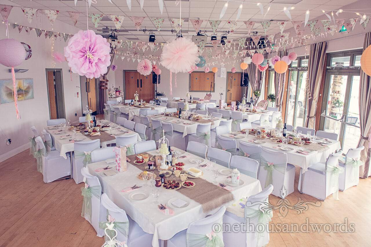 Harmans Cross Village Hall Wedding decorations with bunting and pompoms