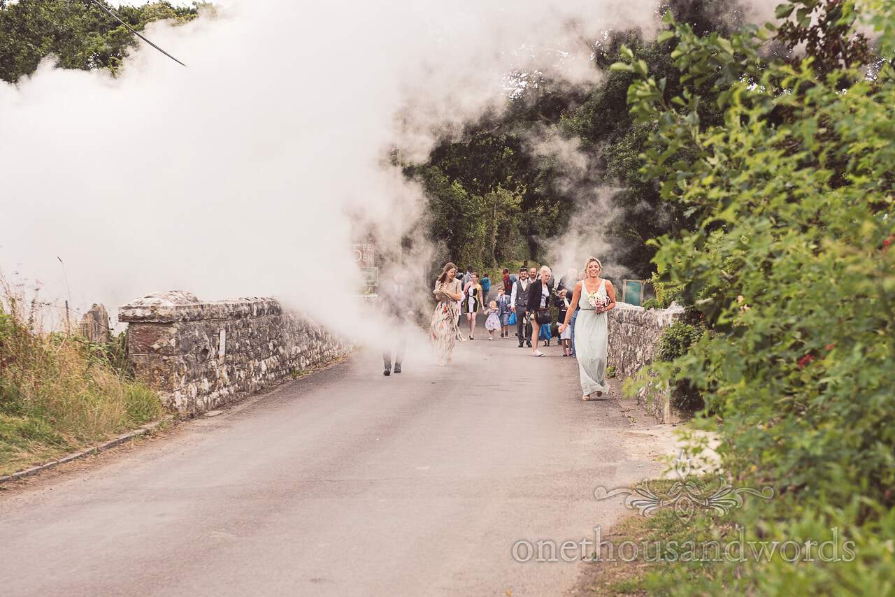 Harmans Cross Wedding photographs of guests arriving through steam train cloud