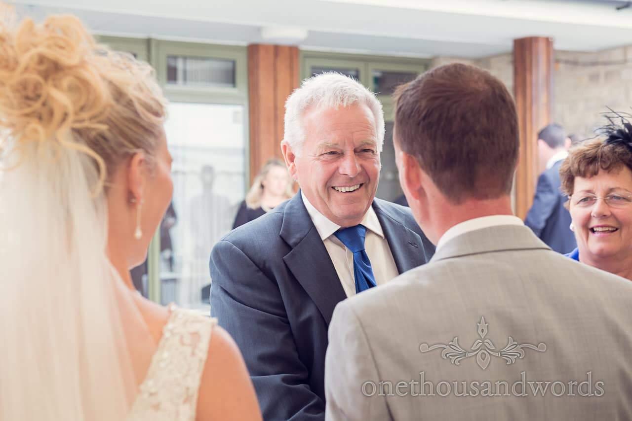 Harmans Cross Wedding photographs of wedding guest greeting bride and groom