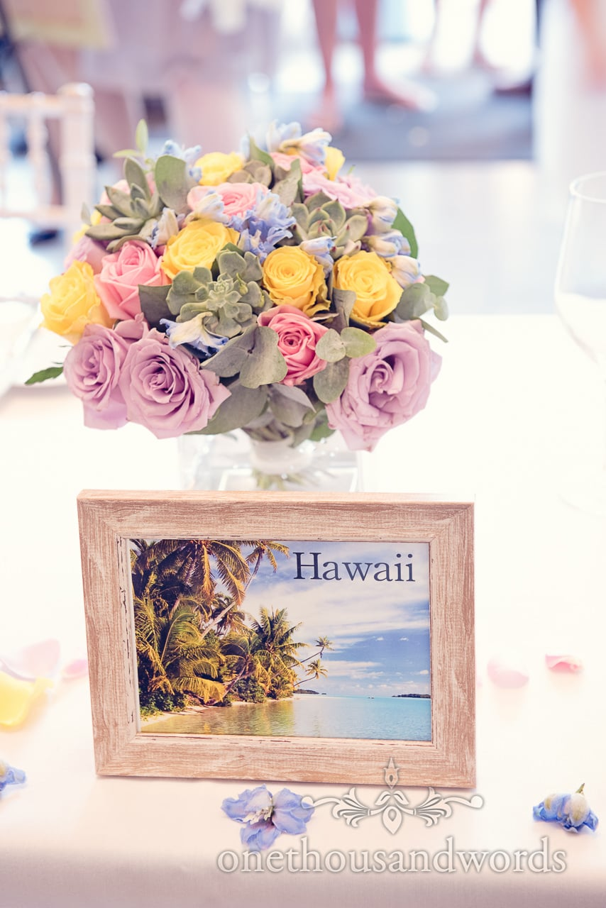 Hawaii wedding table place name postcard in frame with pastel wedding flowers