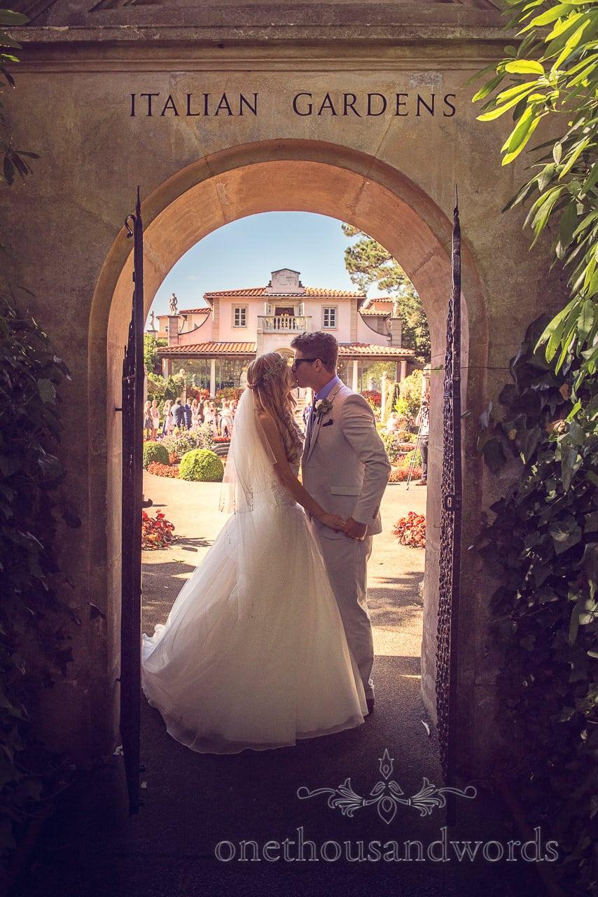 italian villa wedding photographs bride and groom kissing in Italian Gardens