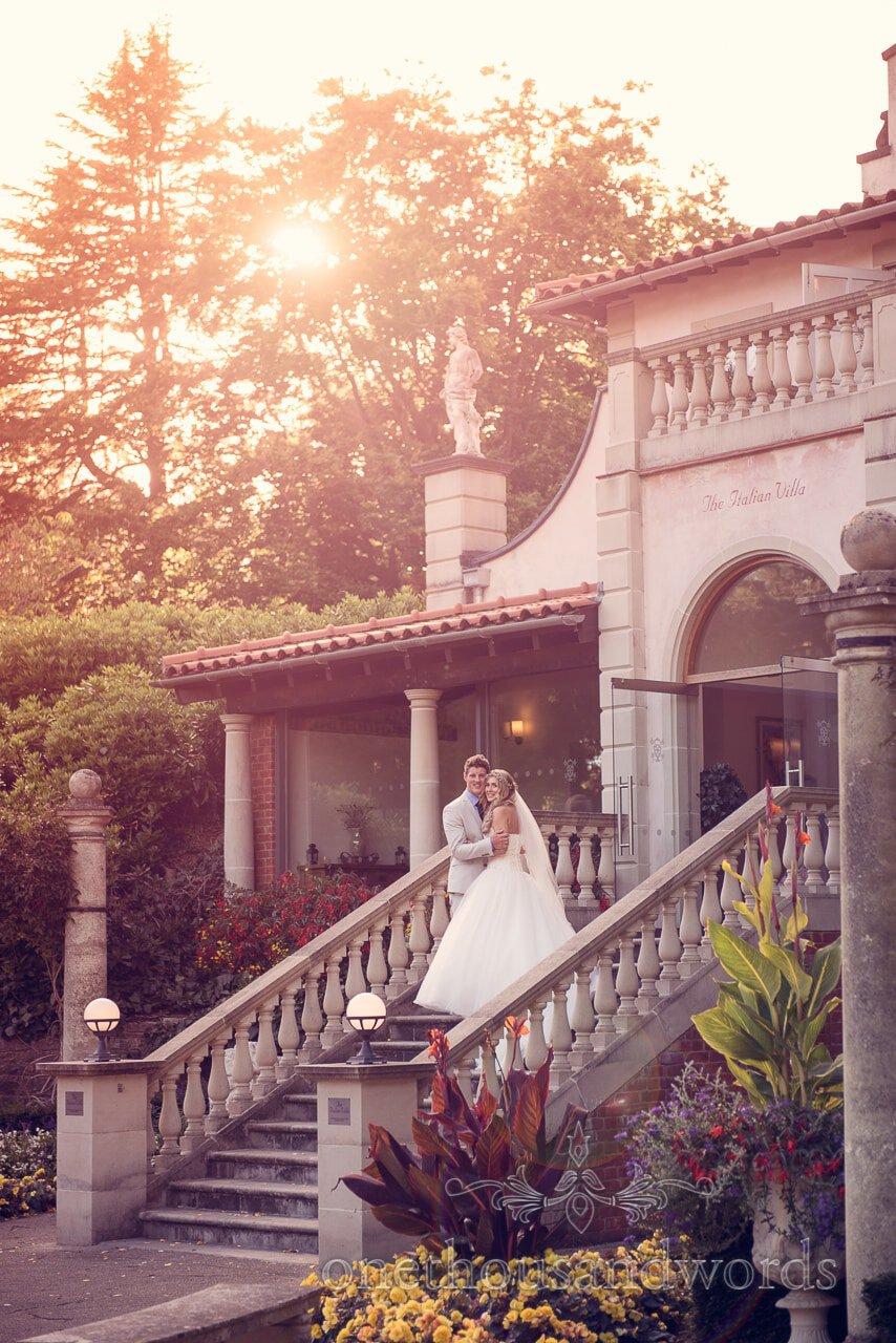 Italian Villa wedding photographs of Bride and groom on stone staircase