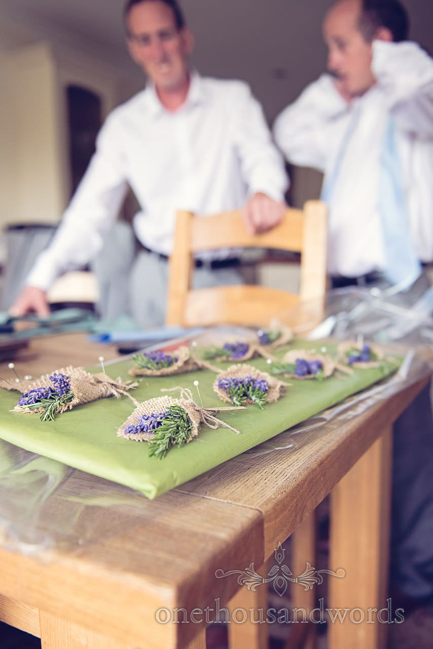 Lavender and rosemary wedding buttonholes made with hessian and string