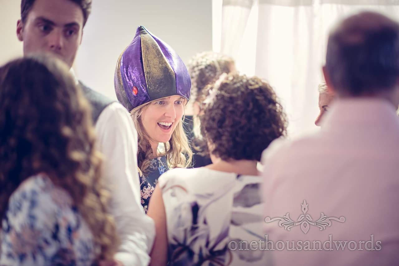 Mother of bride in fancy dress hat at italian villa wedding evening reception