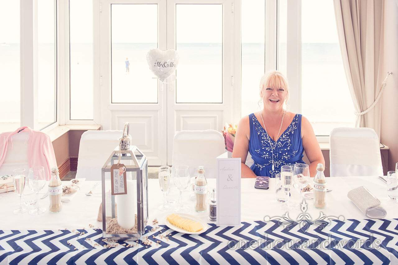 Mother of the bride in blue dress at seaside theme wedding in Dorset