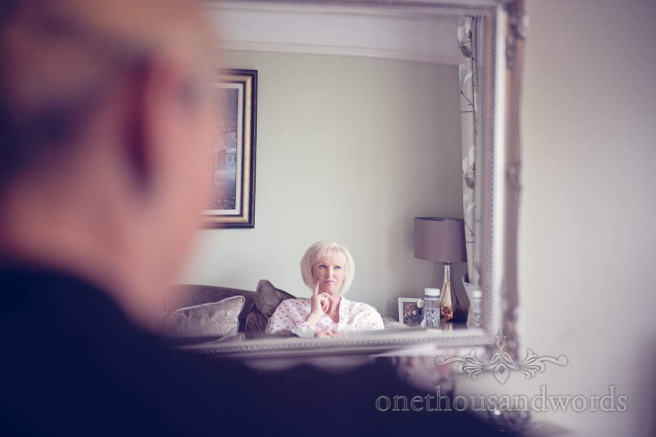 Mother of the bride in mirror on morning of Harbour Heights wedding