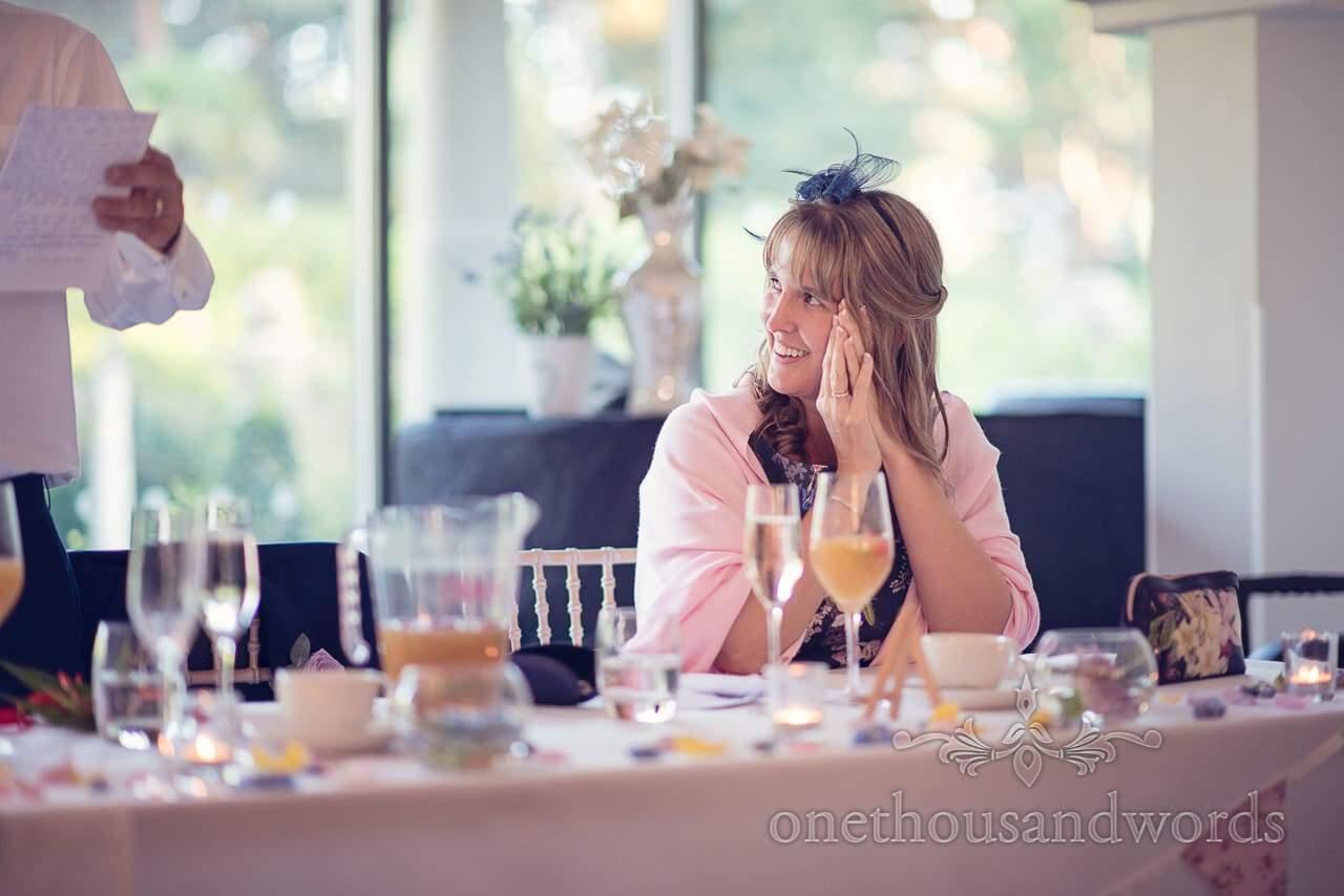 Mother of the bride listens to weddign speeches at italian villa wedding photographs