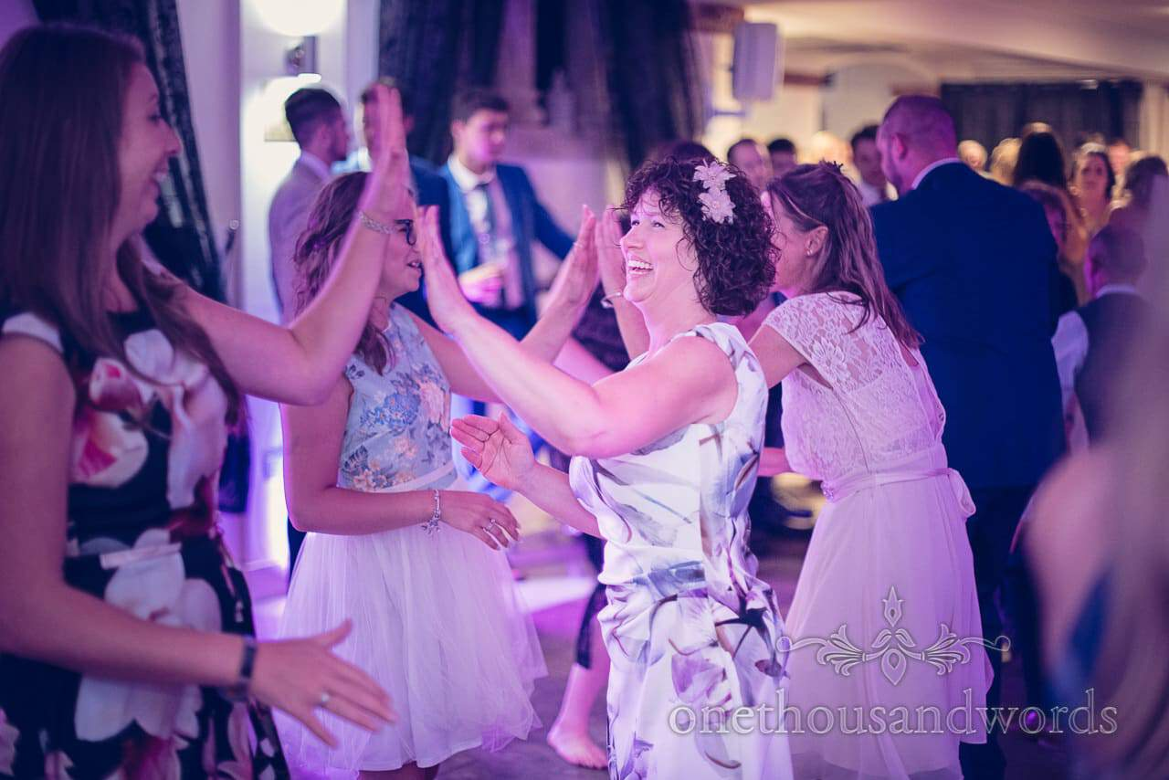 Mother of the groom dancing at Italian Villa Wedding barn dance