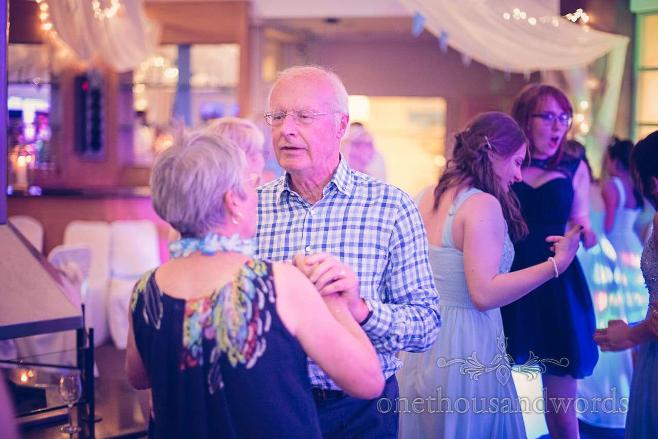 Older wedding guests dancing at Sandbanks Hotel wedding in Dorset