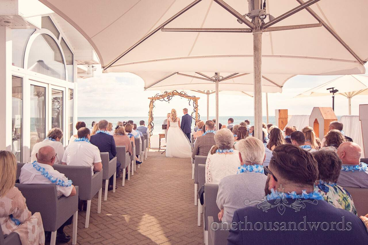 Outdoor wedding ceremony by the beach and sea in Dorset