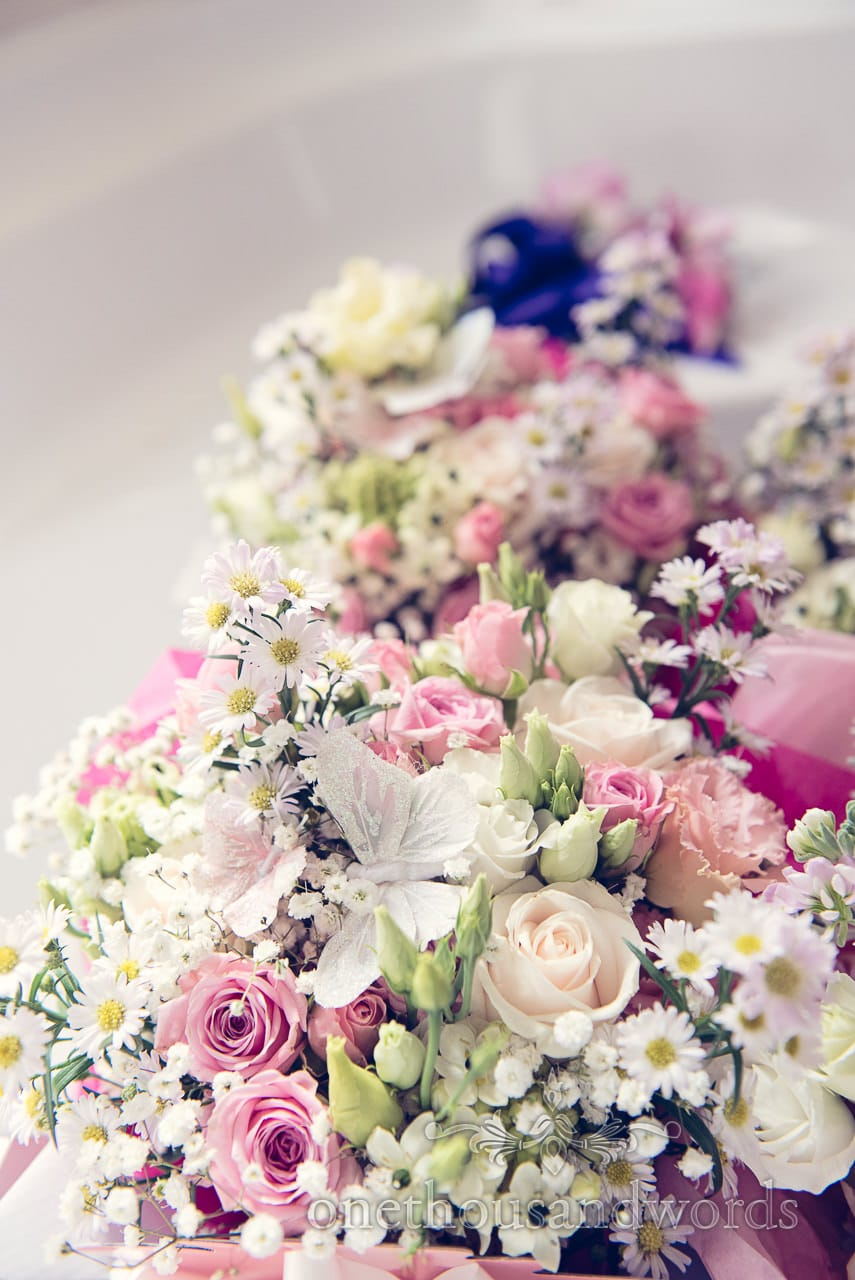 Pastel coloured countryside wedding flowers with butterfly details