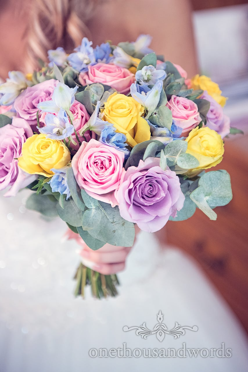 Pastel roses wedding boquet with blues yellows and pinks wedding photograph