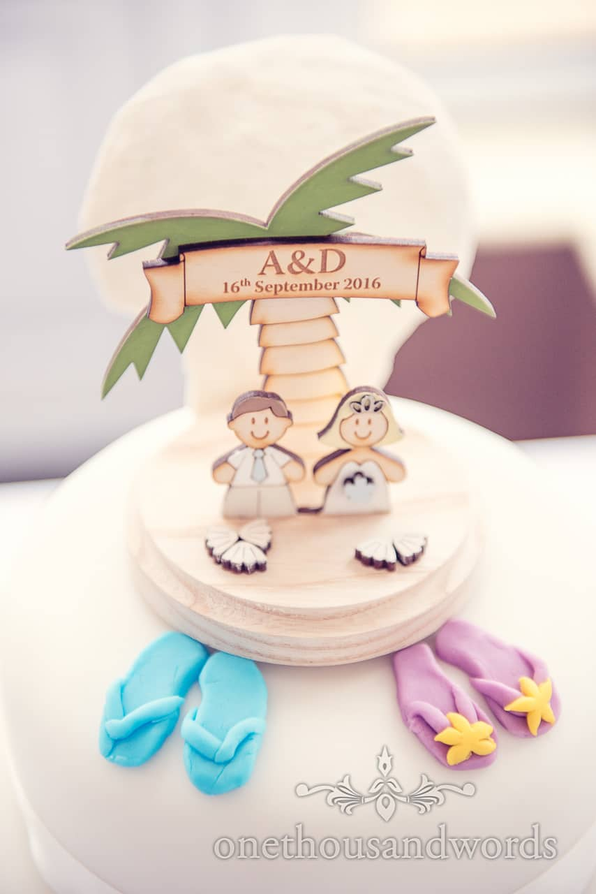 Seaside theme wedding cake topper with palm tree and flip flops