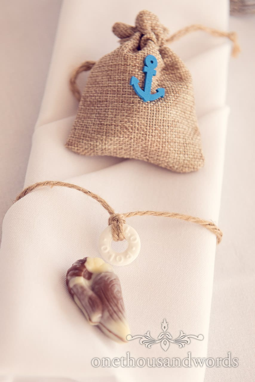 seaside theme wedding details with chocolate shells and hessian gift bags