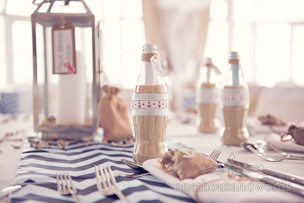 Seaside theme wedding message in a bottle table place names
