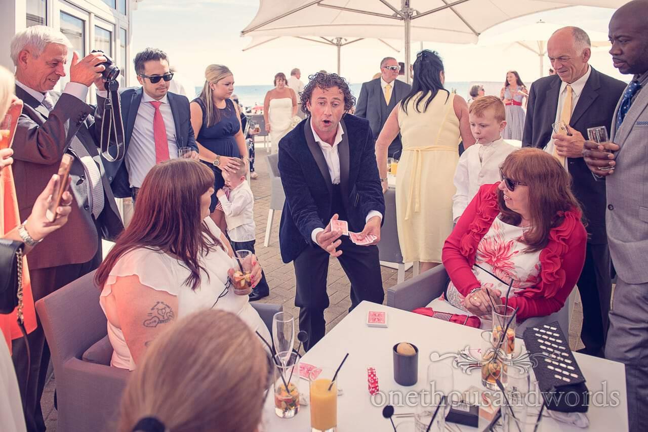 Sean Haydon wedding magician card tricks at Sandbanks Hotel Wedding reception