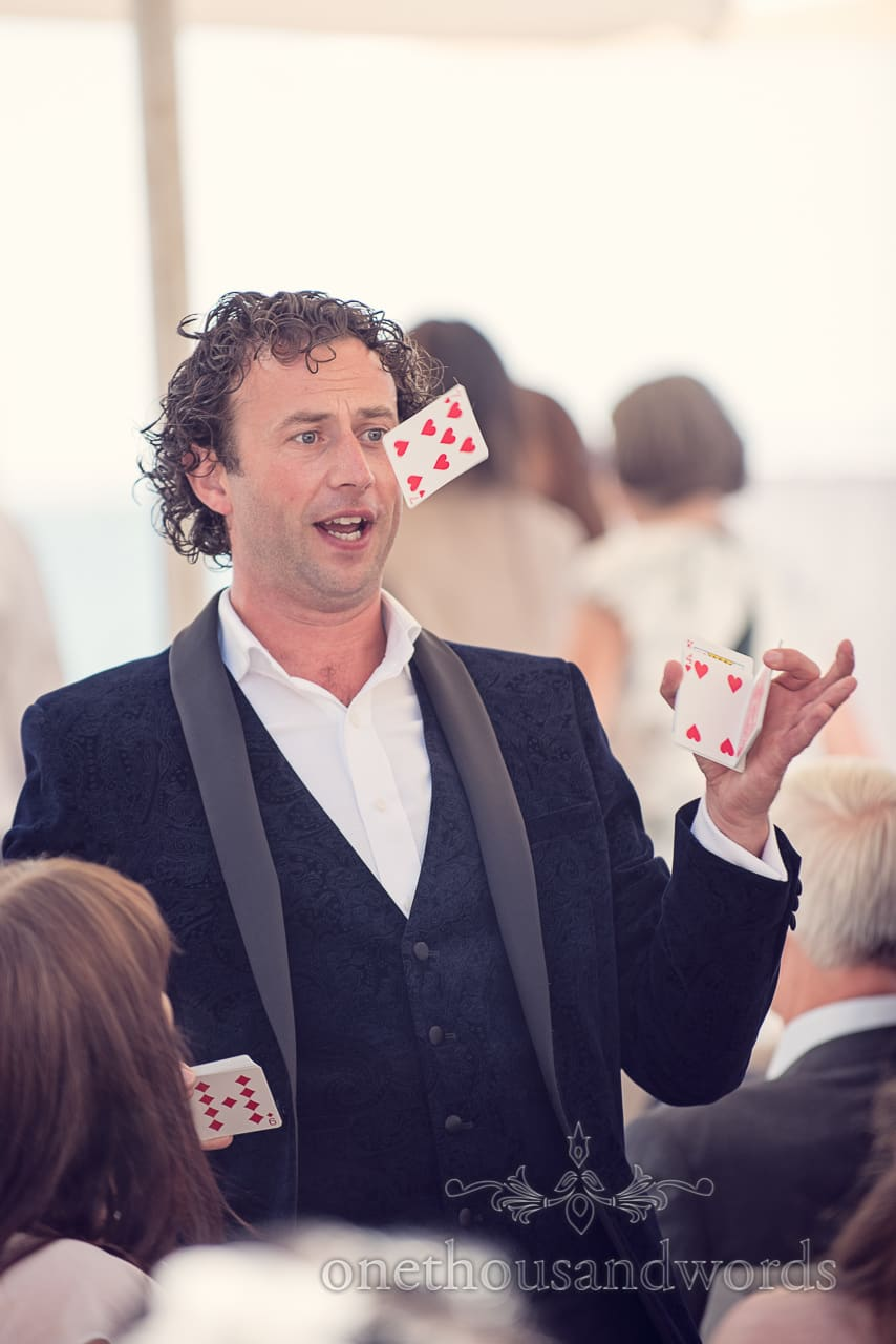 Sean Haydon wedding magician makes playing card fly at Sandbanks Hotel Wedding