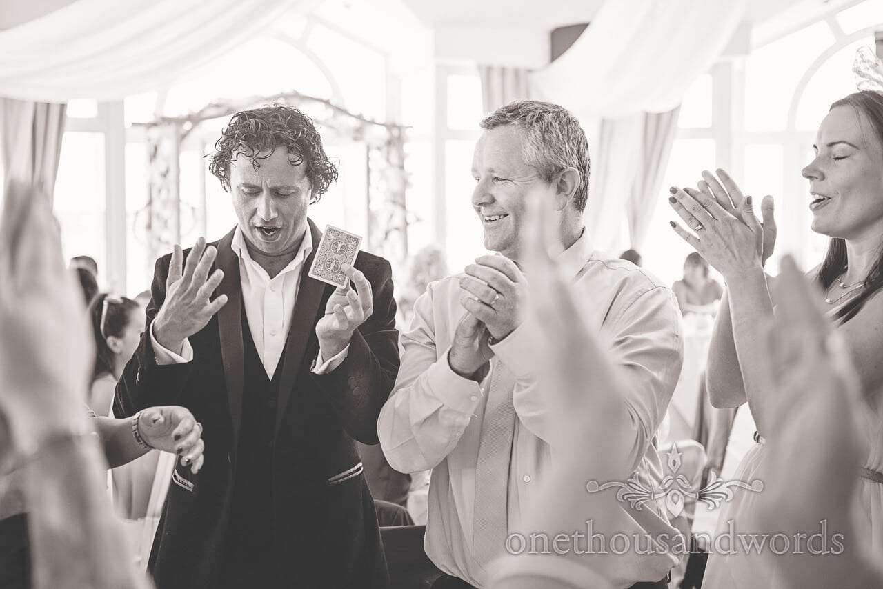 Sean Haydon wedding magician performs card trick at Sandbanks Hotel Wedding breakfast