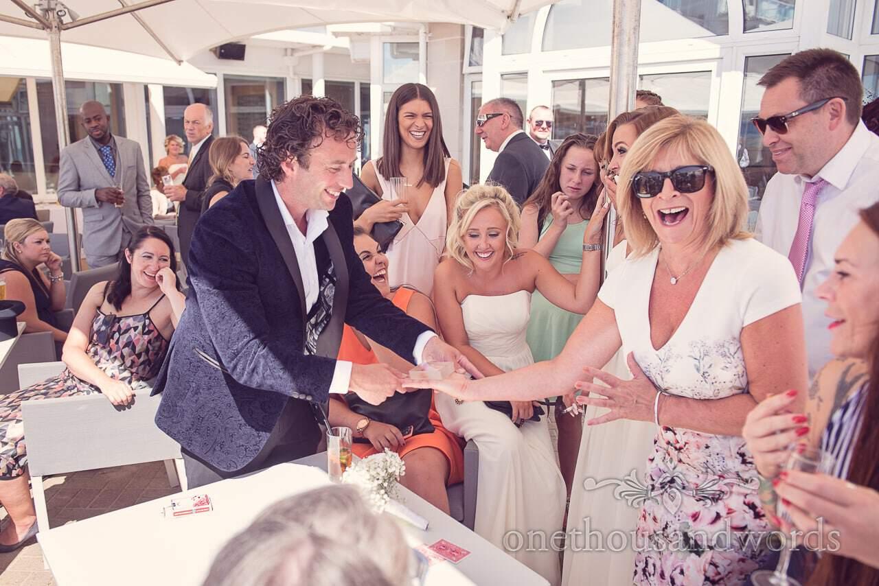 Sean Haydon wedding magician produces goldfish at Sandbanks Hotel Wedding