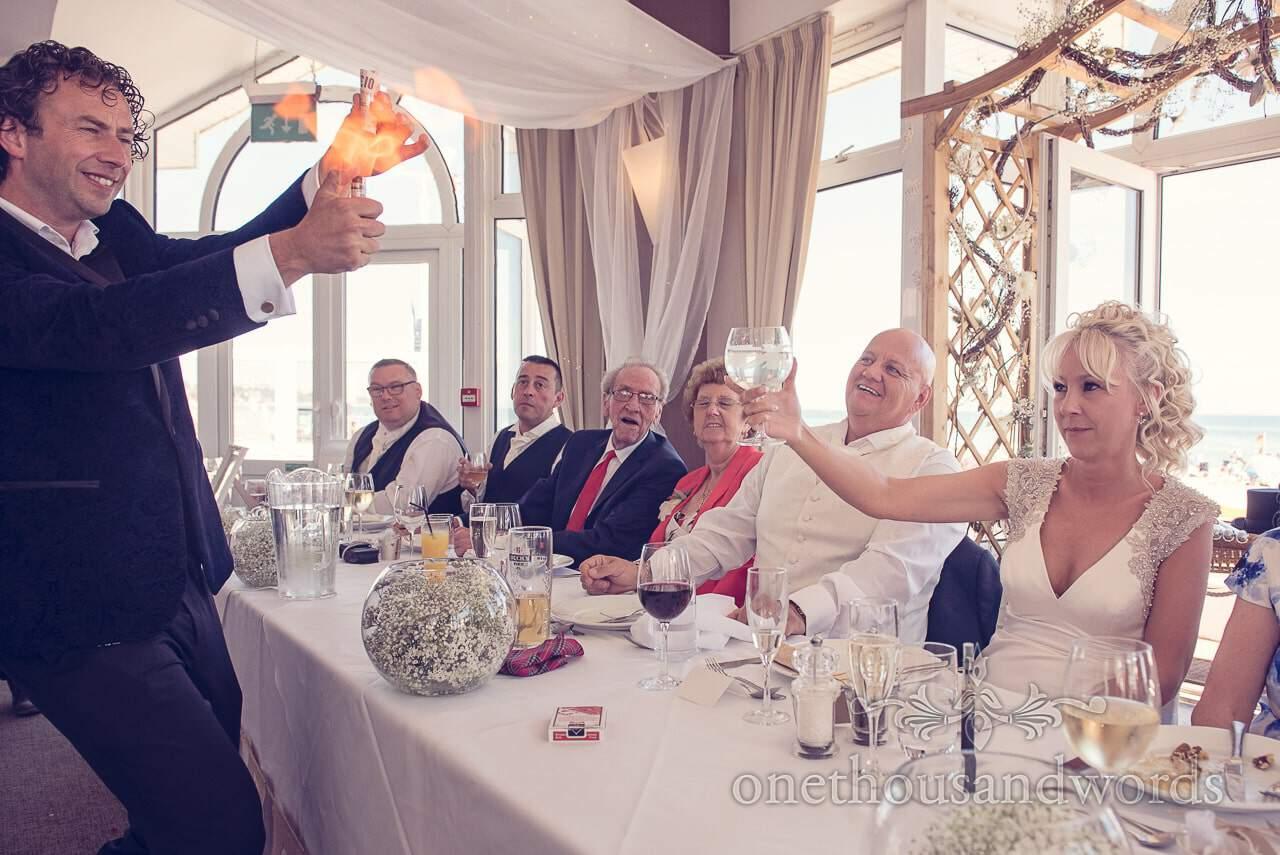 Sean Haydon wedding magician sets fire to money at Sandbanks Hotel Wedding