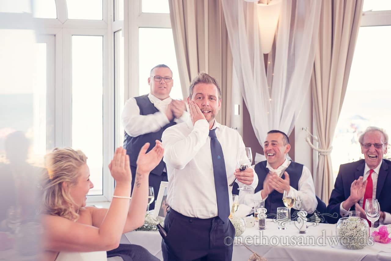 Singing waiter introduces himself at Sandbanks Hotel Wedding in Dorset