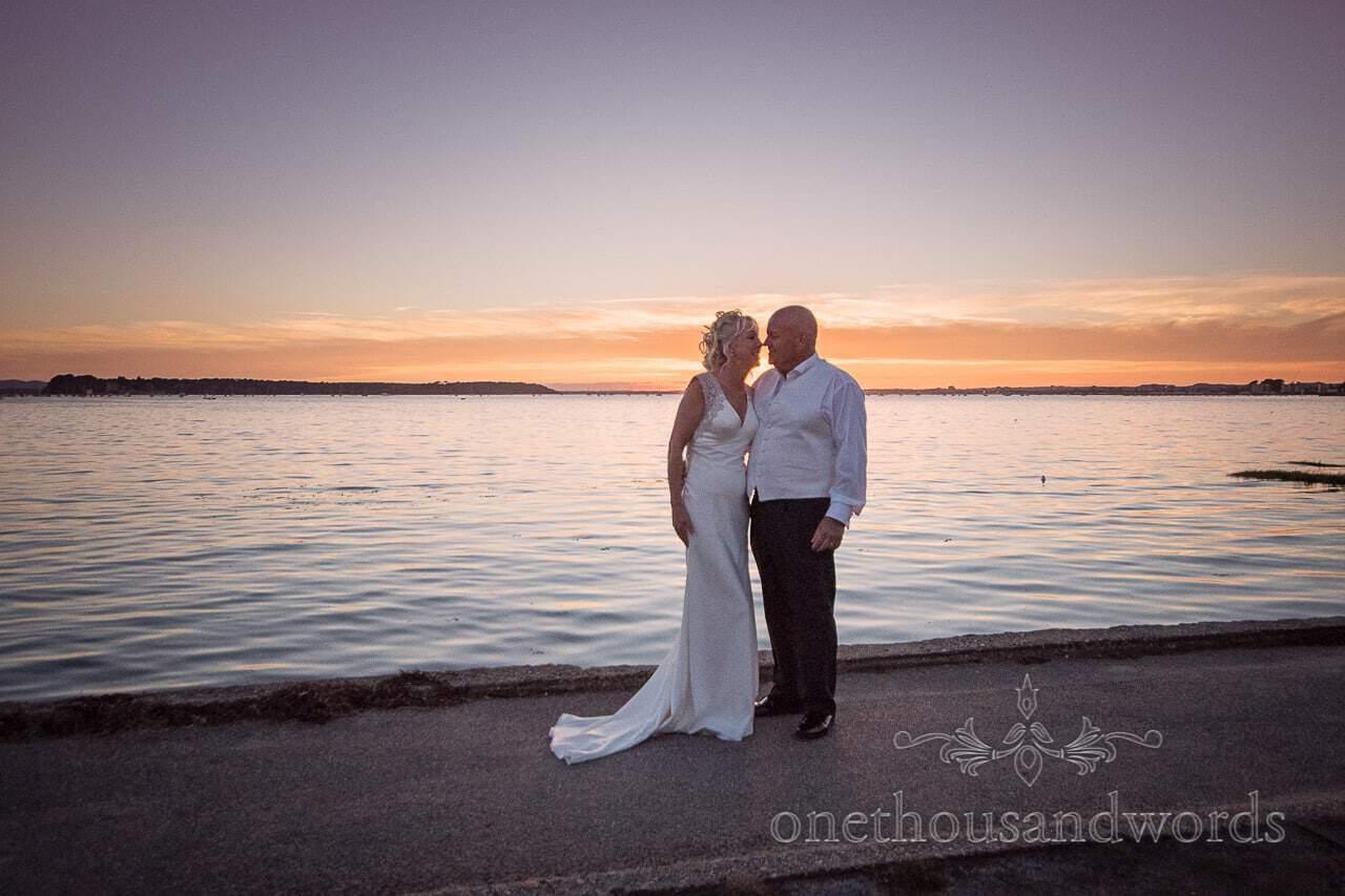 Sunset over sea wedding photograph