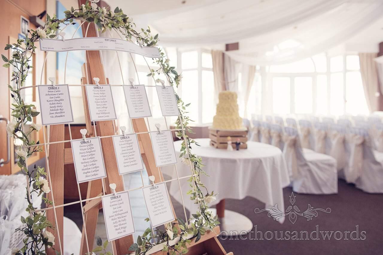 Table plan and cake at Sandbanks Hotel Wedding