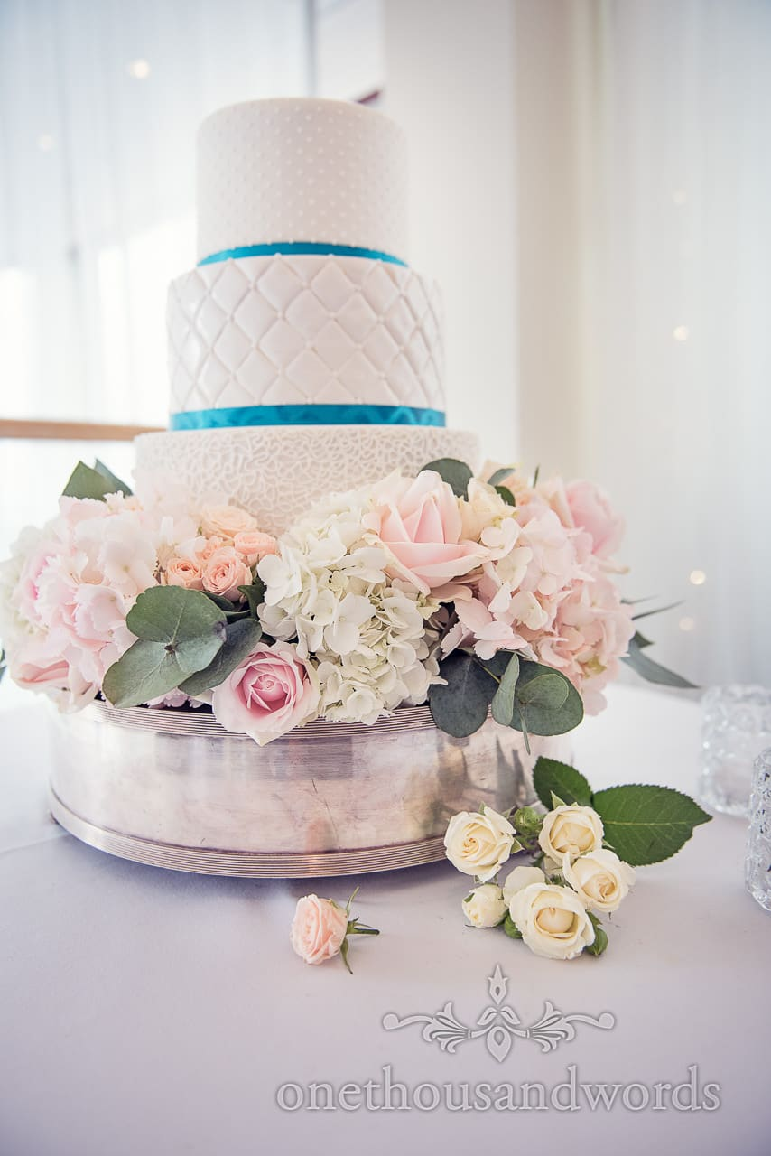 Three tier wedding cake with flower decoration at Harbour heights wedding
