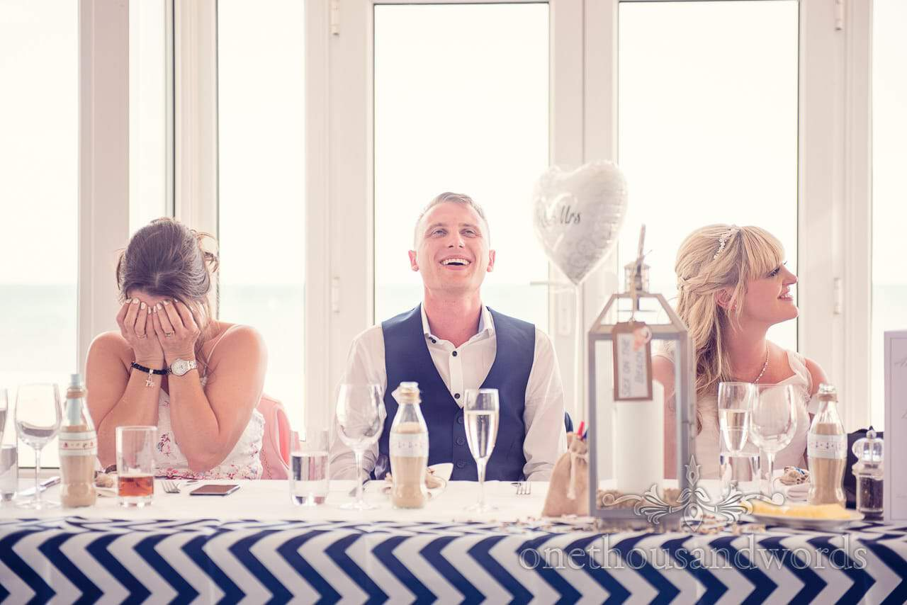 Top table laugh and crying reactions to wedding speeches at Sandbanks Hotel