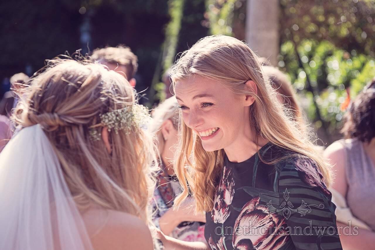 Weddign guest laughs with bride at italian villa wedding drinks reception